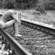 Upset girl sitting on rails — Stock Photo #40818513