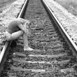 Upset girl sitting on rails — Stock Photo #40818749