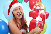 Surprised and happy girl with gifts — Stock Photo