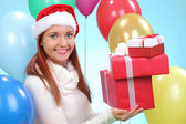 Pretty teenage girl with gifts in their hands — Stock Photo
