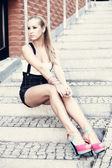 Beautiful girl sitting on the stairs — Stok fotoğraf