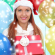 Beautiful girl dressed as Santa with a gift box — Stock Photo #40821551