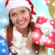 Beautiful girl dressed as Santa with a gift box — Stock Photo