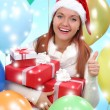 Beautiful girl dressed as Santa with a gift box — Stock Photo #40821701