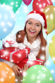 Beautiful girl dressed as Santa with a gift box — ストック写真
