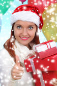 Beautiful girl dressed as Santa with a gift box — Foto Stock
