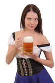 Beautiful young smiling woman giving beer — Stock Photo