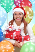 Beautiful girl dressed as Santa with a gift box — Foto de Stock