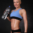Sportswoman with a bottle of water — Stock Photo