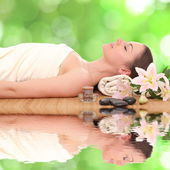 Young and beautiful woman getting spa treatment — Stock Photo