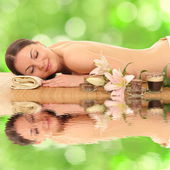 Beautiful woman relaxing in spa — Stock Photo