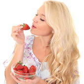 Portrait of young woman with strawberry — Stock Photo