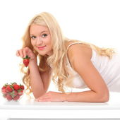 Young beautiful smiling woman with strawberry — Stock Photo