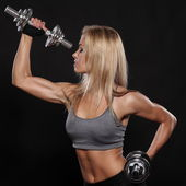 Fitness and Exercise Female Bodybuilder — Stock Photo