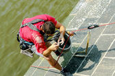 Expert fixes the Charles Bridge in Prague July 22, 2014 — Stock Photo