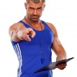Personal Trainer, with a pad in his hand, isolated in white — Stock Photo #38735953