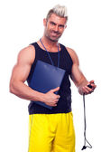 Personal Trainer, with a pad in his hand, isolated in white — Stock Photo
