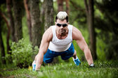 Sport man stretching at the park - fitness concepts — Stock fotografie