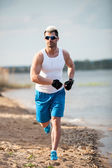 Young Man In Fitness Clothing Running — Foto de Stock