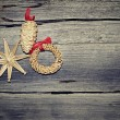 Straw Christmas ornaments on a wooden background — Stock Photo