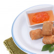 Stock Photo: Delicious spring rolls with spicy thai dipping sauce.