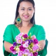 Stock Photo: Young asian woman holding artificial flower and heart shaped r