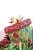 Christmas gift box & red christmas ball — Stock Photo