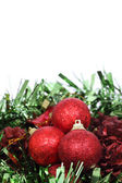 Closeup of Red Christmas balls on white background — Stock Photo