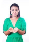 Young asian girl showing something on the palm of her hand — Foto Stock