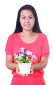 Young woman holding artificial flower, isolated on white backgr — Stock Photo