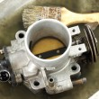 Stock Photo: Cleaning carburetor with gasoline