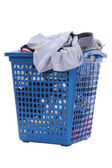Clothes in a blue laundry basket , Isolated background — Stock Photo