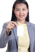 Business woman holding a blank name card , Isolated on white ba — Zdjęcie stockowe