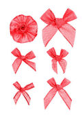 Festive red bows made of ribbon. Isolated on a white background. — Stockfoto