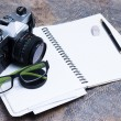 Stock Photo: Group of objects on leather. Camera, diary and pen to note all t
