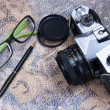 Stock Photo: Group of objects on leather. Camera, pen, ideas and plans. Studi