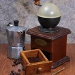 Постер, плакат: Coffee grinder and coffee maker on wooden backgrond