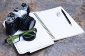 Group of objects on leather. Camera, diary and pen to note all t — Stock Photo