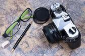 Group of objects on leather. Camera, pen, ideas and plans. Studi — Stock Photo