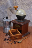 Coffee grinder and coffee maker on wooden backgrond — Stock Photo