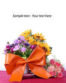Big ribbon with colorful artificial flower — Stock Photo