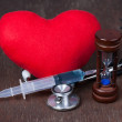 Stock Photo: Medical, Group of objects on wood table. red heart ,stethoscope,