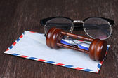 Group of objects on wood table. Hourglass, glasses, envelope , — Stock Photo