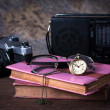 Stock Photo: Group of objects on wood table. old watch, retro radio, camera,