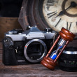 Group of objects on wood table. antique wooden clock, hourglass, — Stock Photo #40047203