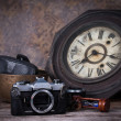 Stock Photo: Group of objects on wood table. antique wooden clock, hourglass,