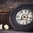 Stock Photo: Group of objects on wood table. antique wooden clock , flower, w