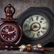 Stock Photo: Group of objects on wood table. old clock, hourglass, antique wo