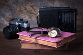Group of objects on wood table. old watch, retro radio, camera, — Stock Photo