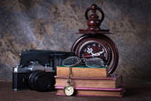 Group of objects on wood table. wood clock, old watch, retro ra — Stock Photo